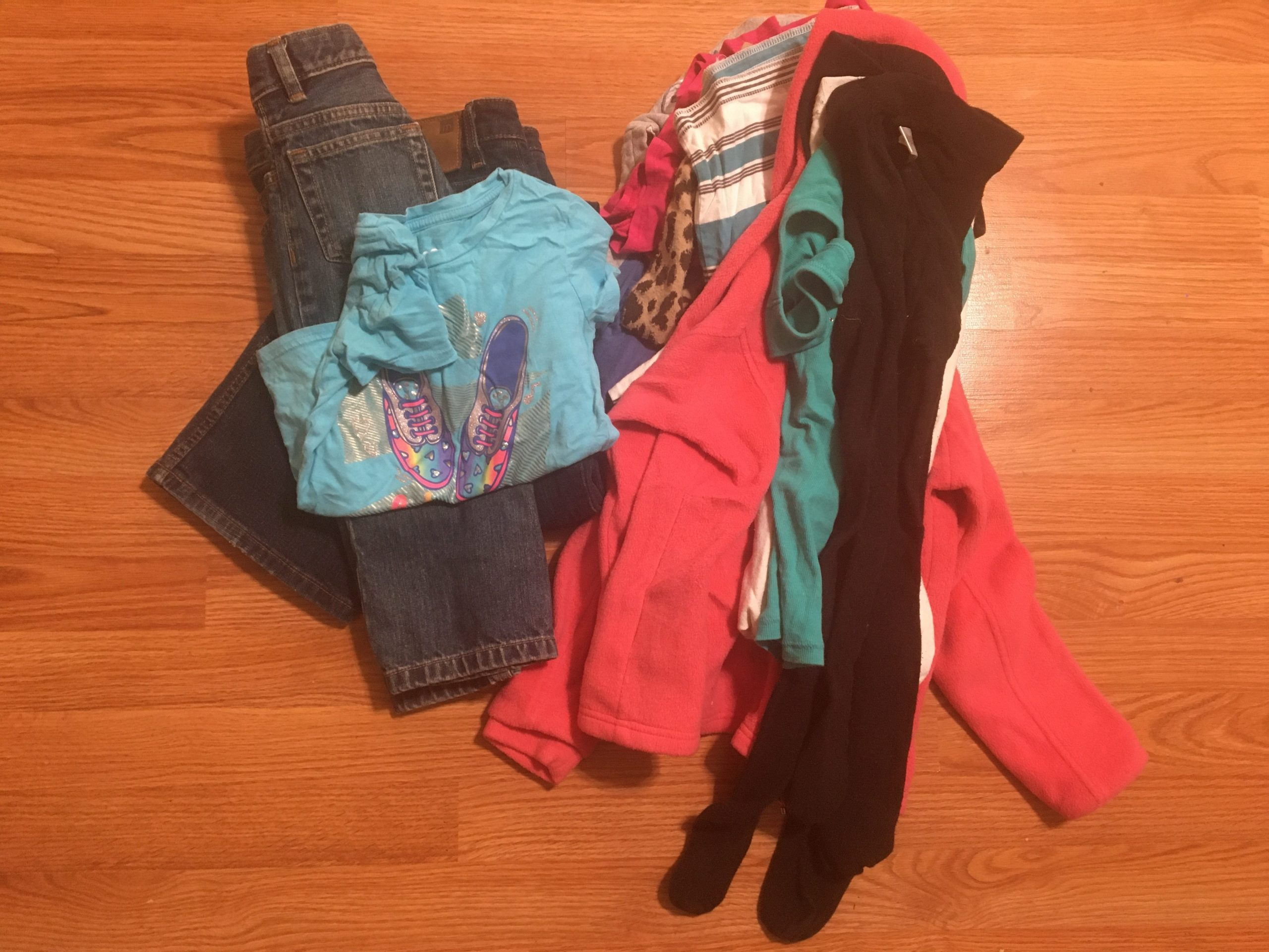 11+ clothing items in piles